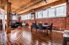Feather Factory Lofts-2154 Dundas St W #107 | One-of-a-kind bright large authentic 1070 sf 2 bedroom SE corner loft with wrap around windows! | More info here: torontolofts.ca/feather-factory-lofts-lofts-for-sale/2154-dundas-st-w-107-2 Exposed Brick Walls, Post And Beam, Wood Ceilings, Beams, Feather, Windows, Lofts, Bedroom, Table