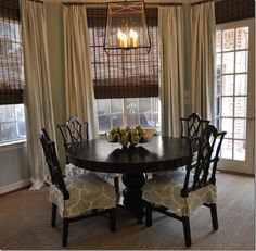 Like the look of the tall curtains mixed with the layers of the other window coverings.   http://www.mobilehomemaintenanceoptions.com/windowcoveringideas.php has some window covering ideas for your home.