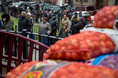 Picture of people lining up to collect food through an assistance program put on by City Harvest Photo by Stephanie Sinclair via National Geographic PROOF