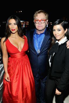 Kim Kardashian in Celia Kritharioti and Sir Elton John with Kourtney Kardashian in Saint Laurent. [Photo by Jamie McCarthy/Getty Images for EJAF]