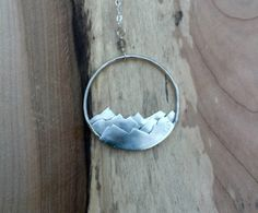 A personal favorite from my Etsy shop https://www.etsy.com/listing/469625379/mountain-range-necklace