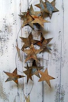 Hand rusted star garland wedding or home decor from Anita Spero Design.This could be done in cardboard and painted to look rusty, or perhaps a glitter garland. Noel Christmas, All Things Christmas, Vintage Christmas, Christmas Crafts, Christmas Ornaments, Metal Garden Art, Metal Art, Navidad Diy, Deco Originale