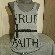 True faith tank top by hybrid apparel True faith tank top by hybrid apparel This is a gently used tank top with black letters TRUE FAITH with a glittering side ways cross  Size M  87% polyester 13% cotton  From a smoke free home Pet friendly home hybrid apparel Tops Tank Tops