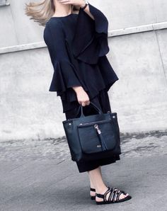 Chloe Plumstead of the Little Plum dreaming of Budapest whilst carrying her black handcrafted Dahlia Tote. Fab!  http://www.vva.co.uk/pages/vva-pr