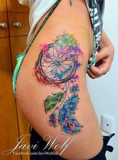 Javi Wolf Tattoo- dream catcher on hip, watercolor