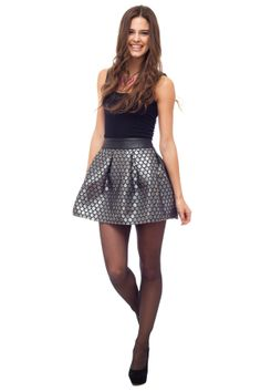 """SILVER SPOON PARTY SKIRT Sparkle the dinner party in this silver metallic skirt with an edgy faux leather waistband.  Fabric: Silver Jacquard, Closure: Invisible zipper with snap buttons, Color: Silver with black, 50% Polyester, 50% Poly Vinyl, Fully Lined  Model Info: Height: 5'7"""" Bust: 31"""" Waist: 23"""" Hips: 33"""" Wears: Small  Festive, new years outfit, dress, black , silver, sparkle, glitter, fashion, party, holiday, style, stylish, brunette, black tights, black heels,"""