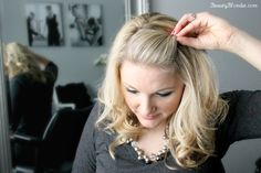 With the opened end of the bobby pin facing the front of the head and insert it into the poof.