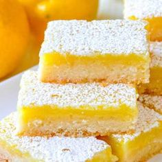 Super Easy Lemon Bars - made with only 5 simple ingredients! With only 5 simple ingredients and an incredibly easy recipe you can bake these luscious lemon bars that all who try, just rave about! Lemon Dessert Recipes, Easy Desserts, Baking Recipes, Delicious Desserts, Yummy Food, Recipes With Lemon, Easy Recipes, Desserts For A Crowd, Blueberry Recipes
