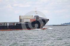 Cargo ship's bulbous bow ploughing through the sea, creating a small bow wave.