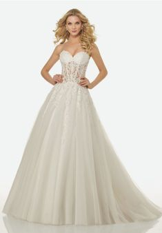 644f5895 Crystal Beaded, Lace Appliqués on a Strapless, Sweetheart, Sheer Bodice  with an A. Kleinfeld Bridal