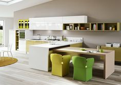 Modern Kitchen Design With And Cool Chair And Table Design And Colorful Furniture Design At The Kitchen With Laminated Wooden Floor And Cream Walls And Integrated Light Wood Dining Table And Unique Yellow Green Pastels Light Wood Dining Table, Dining Table With Storage, Contemporary Bar Stools, Contemporary Kitchen Design, Modern Design, Colorful Kitchen Decor, Kitchen Colors, High Gloss Kitchen, Best Kitchen Designs