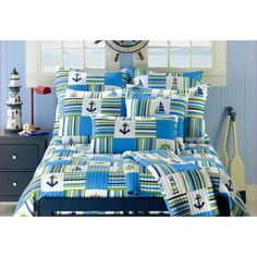 @Overstock.com - Anchor Blue 3-piece Quilt Set - This blue three-piece quilt set is the perfect accent for any bedroom with a nautical theme. Featuring a patchwork design with sail boats, lighthouses, ship wheels, and anchors, this cotton quilt set will keep you comfy while you dream of the sea.  http://www.overstock.com/Bedding-Bath/Anchor-Blue-3-piece-Quilt-Set/7896282/product.html?CID=214117 $91.99