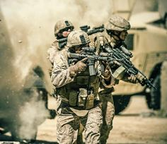 Marines engaged in combat. Doing what they do best.  God bless our Marines.