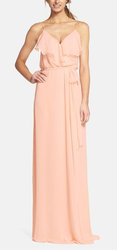 The girls will look lovely on the big day in this peachy hue ruffle-front gown.