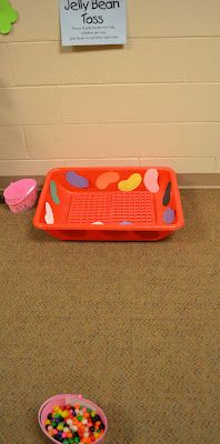 Easter Party Game- Jelly Bean Toss- Toss Jelly beans or jelly bean shaped Easter eggs into the basket. Read Jelly Bean Colors Poem