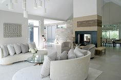 Modern Farmhouse by Betty Wasserman- idea for fireplace and then have stairs be located where the block wall is shown