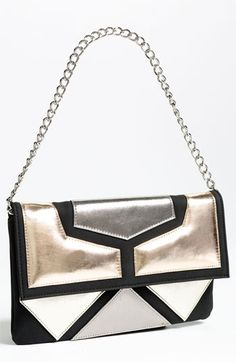 SR Squared by Sondra Roberts Blocked Metallic Clutch Metallic glint adds chic edge to a geo-appliqued clutch furnished with an optional shoulder strap.