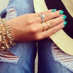 Ripped jeans, teal mani, and a splash of gold.