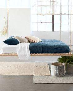 Create a serene and relaxing bedroom with our Eileen Fisher Home collection.