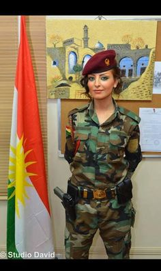 Very beautiful, and  cool. Kurdish soldier.