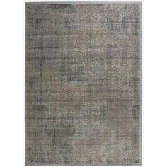Expert  hand carving and raised high-low loop pile construction give this area rug extraordinary touch appeal. Sublime shading in subtle gradations of grey impart a damask design with an intriguing air that will lend an exotic allure to any setting.