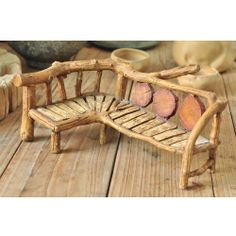 """Long Gnome Bench is the perfect conversational piece to accent a majestic fairy garden. Plenty of room for gnomes and fairies to host their guest. Easily accessorize with pillows here and there if you choose to make this bench even more cozier. Beautifully crafted to display a wood tone to easily fit in to any fairy garden setting. Dimensions: 4"""" H (back) 1 3/4""""(seat) x 9 1/2"""" L x 6"""" D Bench 2-2 1/2"""" D Material: Poly-resin $22.95"""