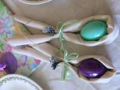 folding the cloth napkins and adding ribbon and flowers to look like a Bunny. Insert colored egg!