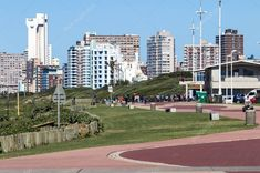 DURBAN, SOUTH AFRICA ; APRIL 15, 2017: Many unknown people on paved promenade against Durban city skyline in South Africa