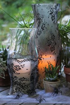 Learn how to create a DIY Halloween centerpiece with lace-covered hurricane lamps and succulents
