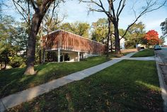Dwell - Contemporary Kansas Home with Wood Slatted Exterior Screen