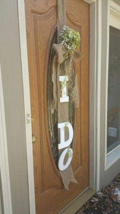 "bridal shower decor! ""I do""  hanging door decoration!  Burlap, wood letters, fake flowers, a big bow, and a little elbow grease!"
