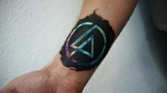 LP logo tattoo, on the inner wrist area of right arm. lp