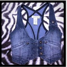DENIM VEST Denim jean vest that is perfect for the summer! 75% cotton 24% polyester 1%spandex. In perfect condition and only worn one time! Tops