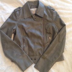 Rachel Roy Army Faux Leather Moto Jacket NWOT Gorgeous Rachel Roy faux leather moto jacket in army green. Beautiful quality... Feels and looks like real leather. Brand new. Pulled tags off to wear, and never ended up wearing it. Front zip closure, 2 functional front zip pockets. Double snap closure tabs at hem and neck. Size med. true to size. Lightly lined. Great for all seasons. ❌ NO TRADES ❌ NO PP❌ NO LOWBALLING ❌ RACHEL Rachel Roy Jackets & Coats