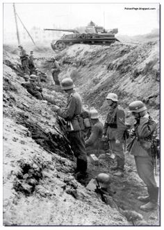 German soldiers in a Soviet-dug trench wait for orders to attack.