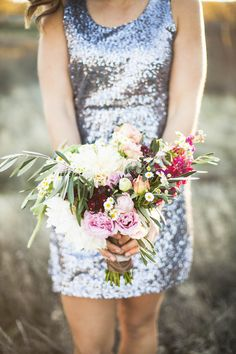 The bridesmaids carried bouquets of roses, dahlias, stock, chamomile, and olive leaves. |   Photographer: Samantha McFarlen | Photographer,  Photographer: Emily Louise Photography