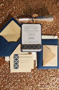 navy and gold invitations, photo by Blue Rose Photography http://ruffledblog.com/seattle-new-years-eve-wedding #invites #weddinginvitations