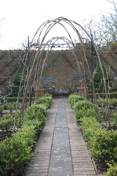 shots of a classic country house potager  tunnels unplanted in the potager...