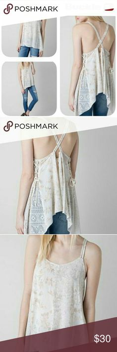 Gimmicks by BKE Floral tank Cream floral tank with drapey fit, straps that cross in the back, shark bite hem, crochet up the sides of the top. BKE Tops Tank Tops