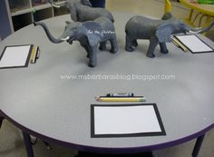 We are doing a GEMS (Great Explorations in Math and Science) unit called Elephants and Their Young. Day 1: Still Life Art. Art paper matted on black, pencil, colored pencils (black and white) black crayon.