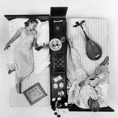 """Public demonstration of the """"cultural bed"""" designed by Ely Alexander, central divider contains shelves for books, sheet music, sculpture, or painting, built in record player and cabinet, and coffee pot on heat proof serving board. 1957 (Yale Joel—Time & Life Pictures/Getty Images)"""