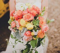 Cascading bouquet with garden roses, dahlia, succulents, craspedia + wild jasmine vine