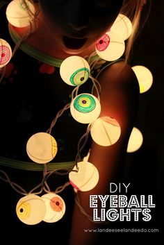 DIY Eyeball Lights using ping pong balls, markers and Christmas lights!- *Only do with LED lights, ping pong balls are flammable*