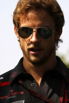 Jenson Button, Formula 1 MBE is a British Formula One driver from England currently signed to McLaren. He is the 2009 Formula One World Champion, driving for Brawn GP