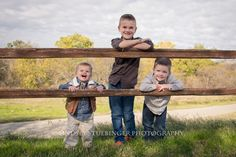 Lindsey Stuebinger Photography #threeboys three boys by the fence #brothers…