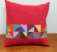 Red Patchwork Quilted Pillow with Wonky Circles. $150.00, via Etsy.