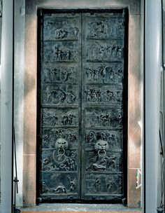 Elaborate Bronze doors of Bishop Bernward. Abbey church of Saint Michael Hildesheim Germany. The elaborate details and stiff figures are both characteristics of Medieval art.
