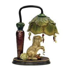 Little accent lamp with rabbit sitting under a cabbage-leaf canopy with a large carrot. This one has a Victorian feel.