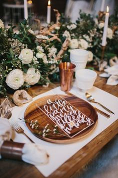 Wooden place settings, hand lettering, lush foliage styled arrangements = Perfection.