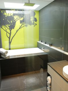like the wall...and slight shelf... great idea shower and bathroom in one...